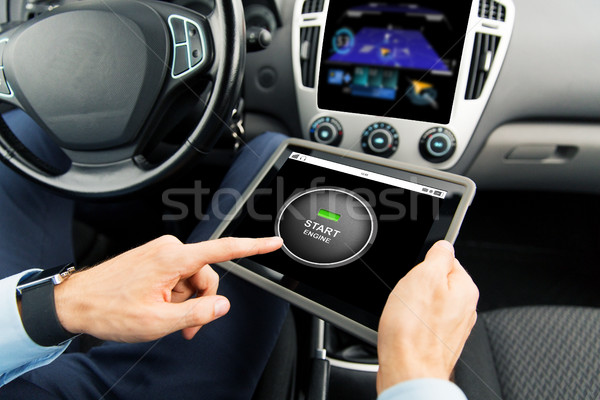 Foto stock: close up of man with tablet pc in car
