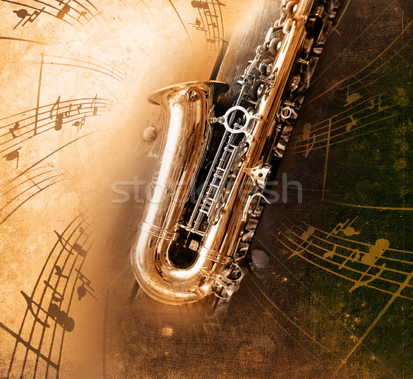 Foto stock: Old Saxophone with dirty background